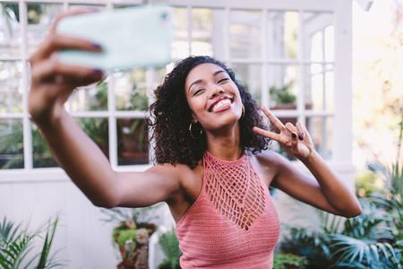 Happy african girl taking selfie