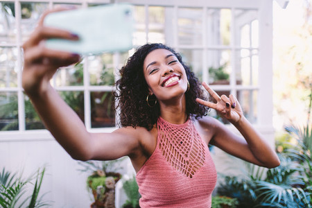 Happy african girl taking selfie
