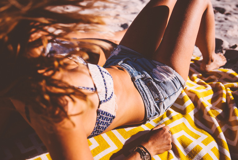 Woman tanning  relaxing at beach