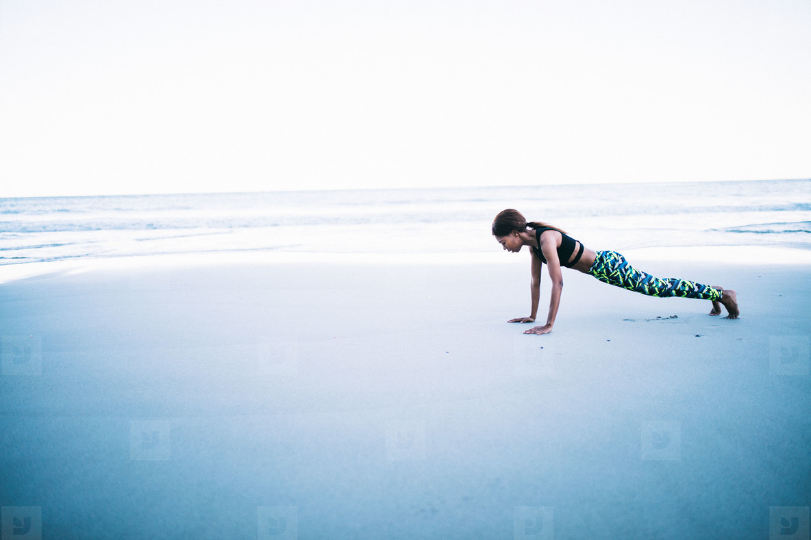 Young female athlete exercising