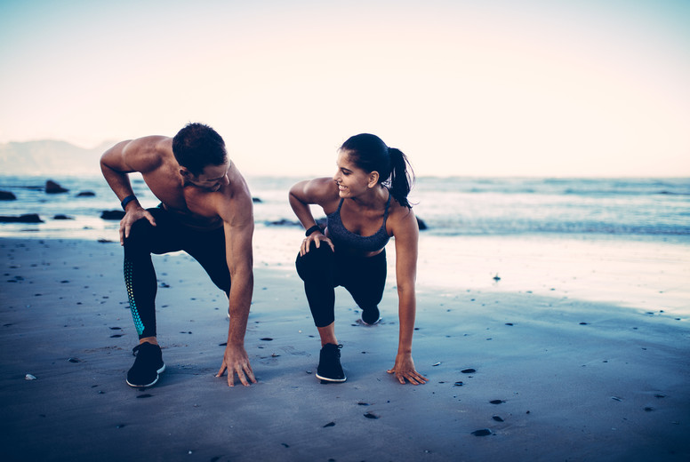 Sporty fitness couple exercising