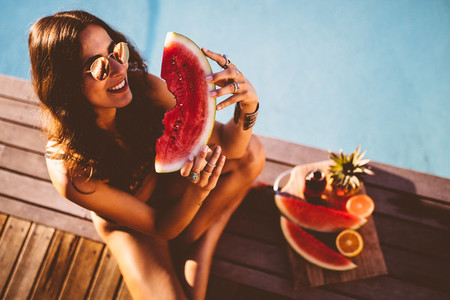 Woman eating fresh watermelon