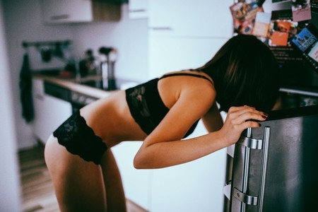 woman in underwear in kitchen