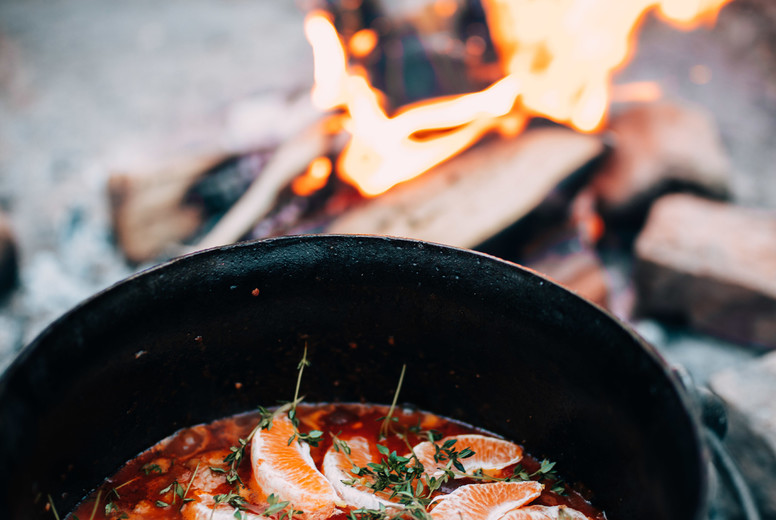 Cooking soup over open fire