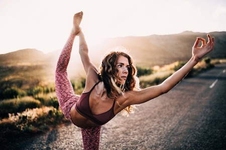 Young woman doing yoga pose