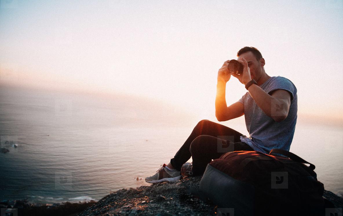 Tourist taking photo with camera
