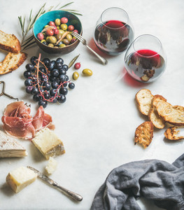 Cheese  olives  grapes  prosciutto  baguette and red wine  copy space