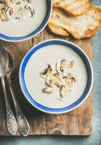 Close up of Creamy mushroom soup in bowls with toasted bread