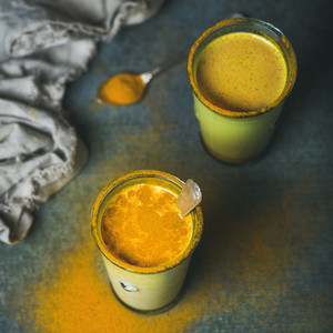 Golden milk with turmeric powder dieting and weight loss concept