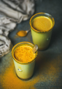 Golden milk with turmeric powder  natural cold fighting healthy drink