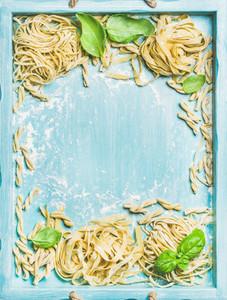 Various homemade fresh uncooked Italian pasta