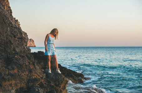 Young blond woman looking at still water Alanya Turkey