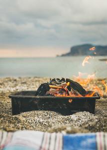 Mangal with burning coal at sea coast Alanya Turkey