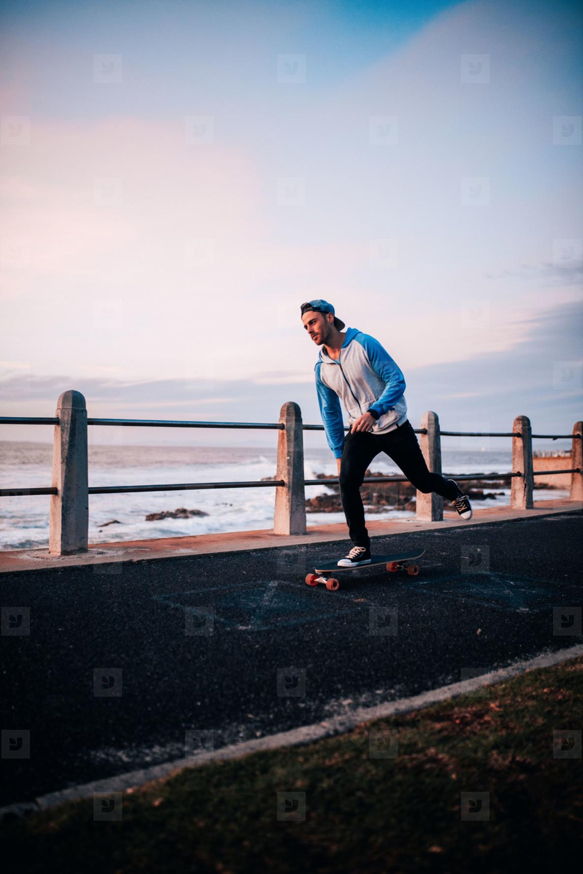 Man longboarding on promenade