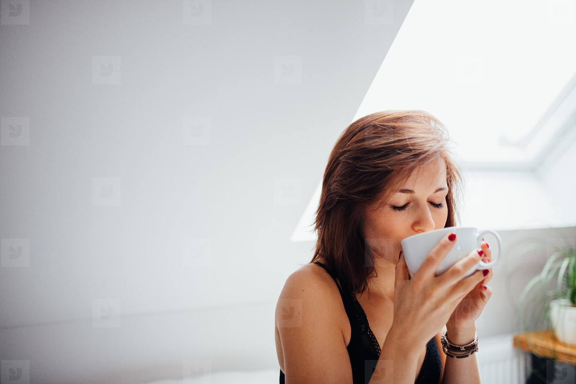 Woman enjoying cup of fresh tea