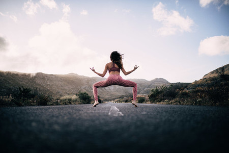Yoga Girl Meditating on road