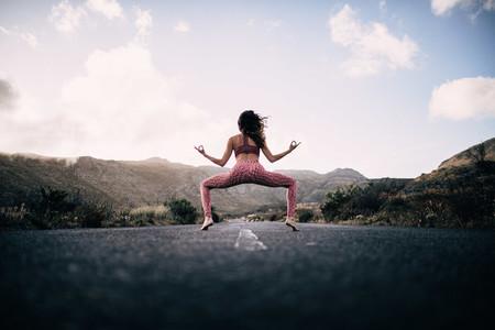 Yoga Girl Meditating on road