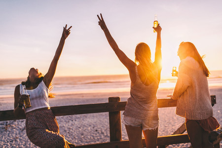 Happy Friends cheering on beach
