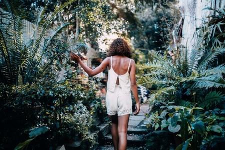 Woman in tropical garden