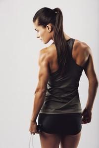 Female bodybuilder holding skipping rope