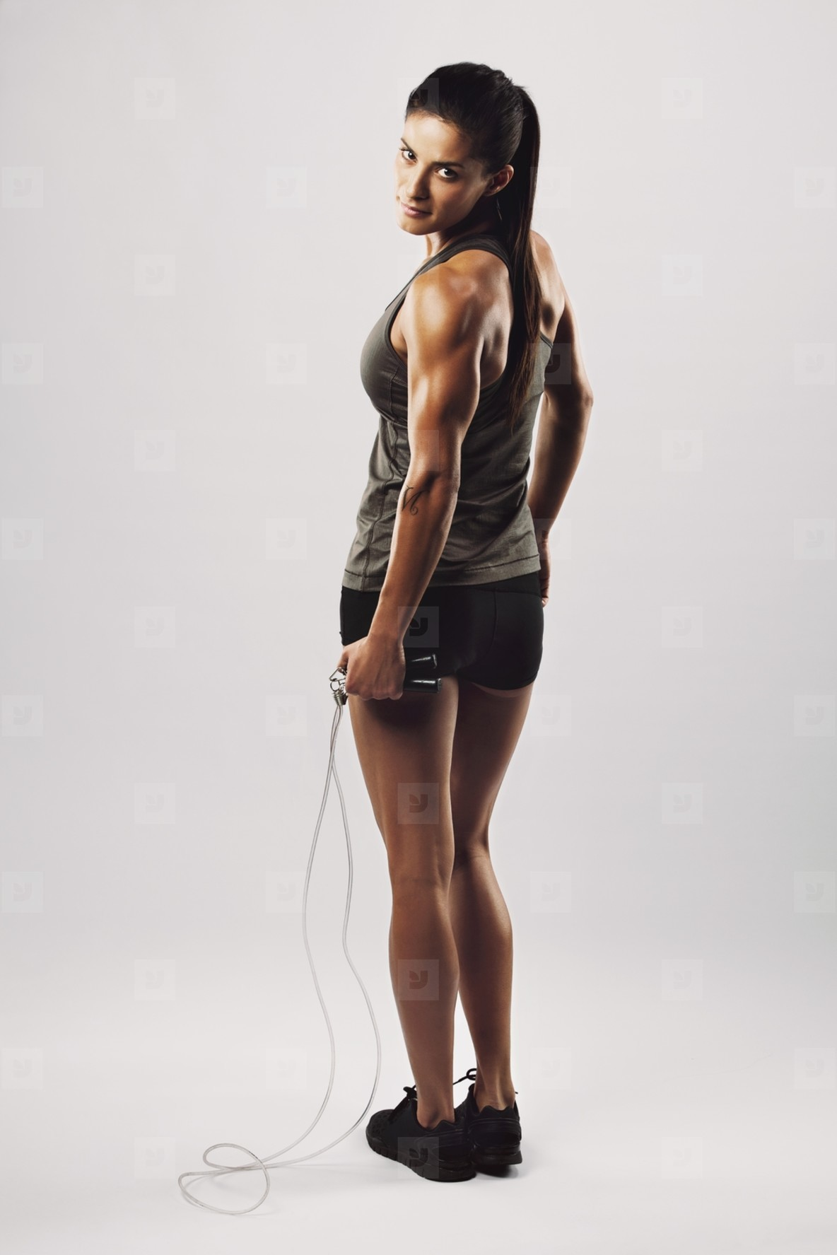 Fitness woman posing with skipping rope