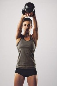 Woman working out with kettle bell
