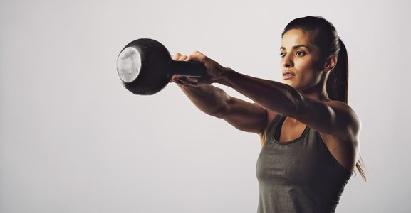 Woman exercise with kettle bell   Crossfit workout