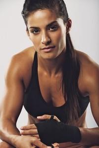 Female boxer preparing for fight