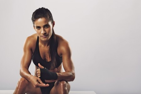 Woman boxer getting ready for workout