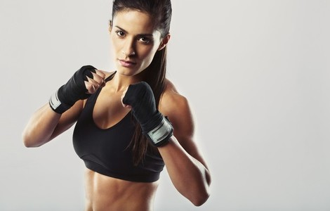 Female fighter posing in combat pose