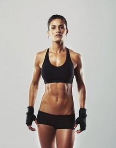 Tough young woman with muscular body