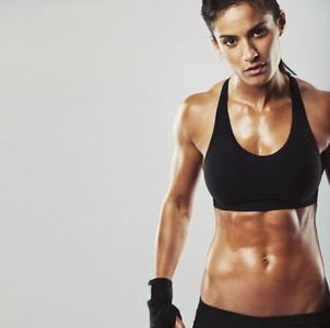 Female fitness model on grey background