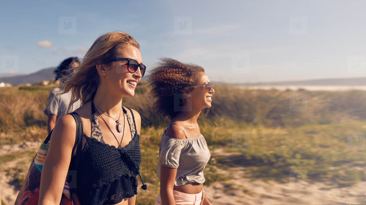Young women going on the beach