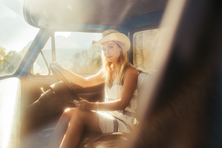 Attractive young woman on a road trip