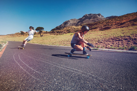 Young people practicing long board riding