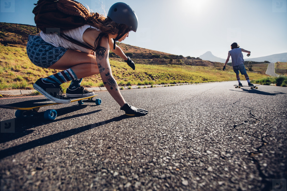 Young woman skating with her friend
