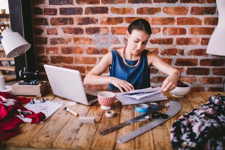 Young businesswoman working on desk with stationary