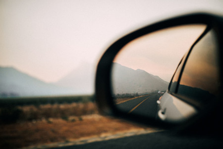 Amazing view of mountains in side mirror of car on roadtrip