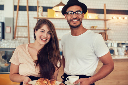 Couple with food and drink at coffee shop