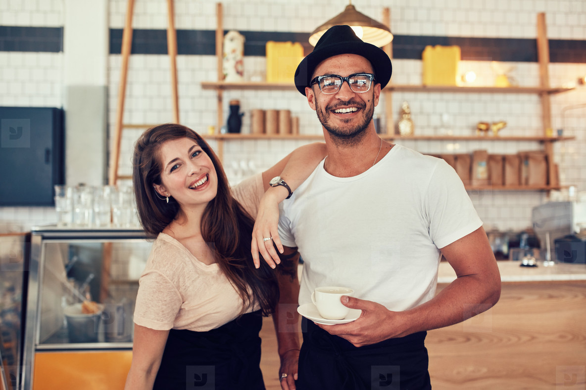 Young man and woman at cafe with a cup of coffee