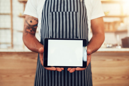 Barista holding digital tablet