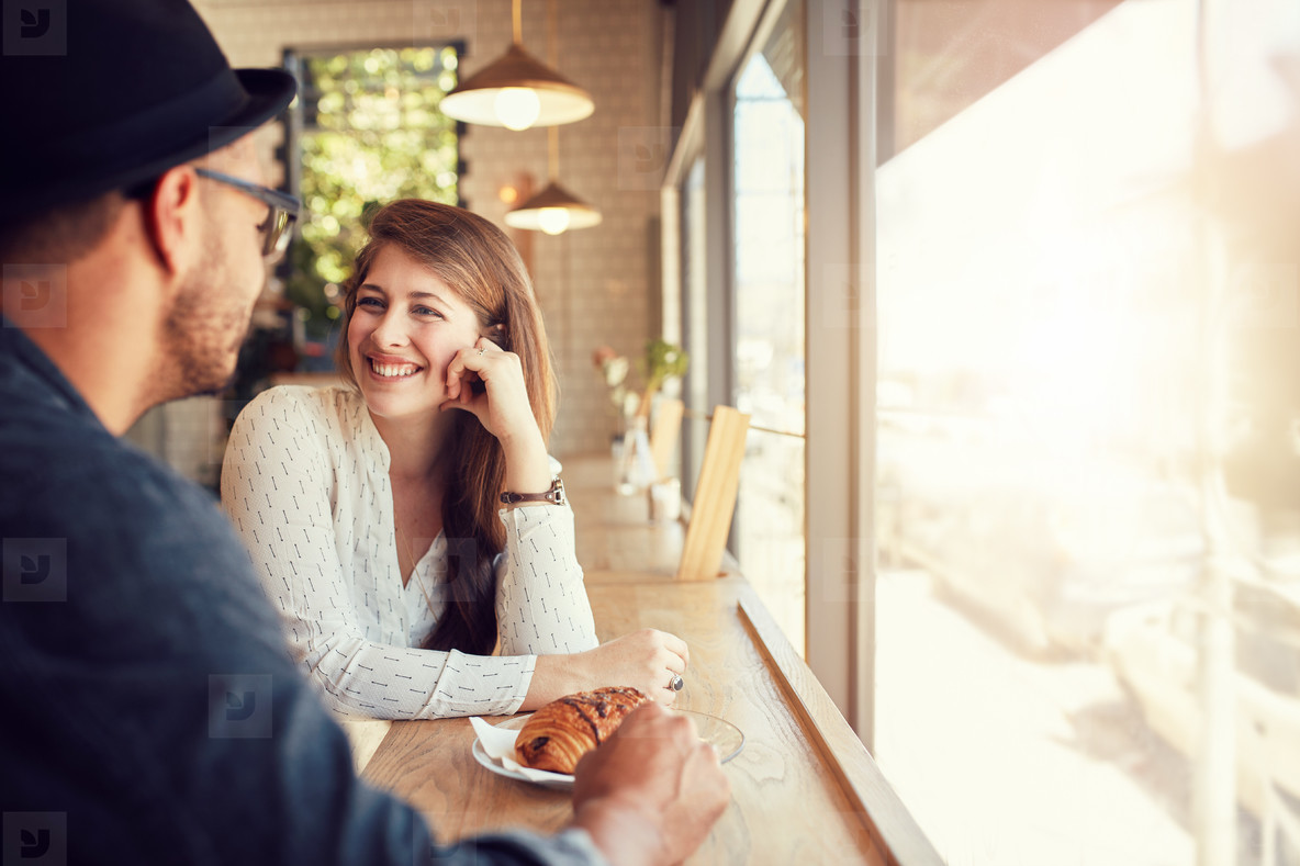 c1043d96479d Photos - Happy young couple at coffee shop - YouWorkForThem