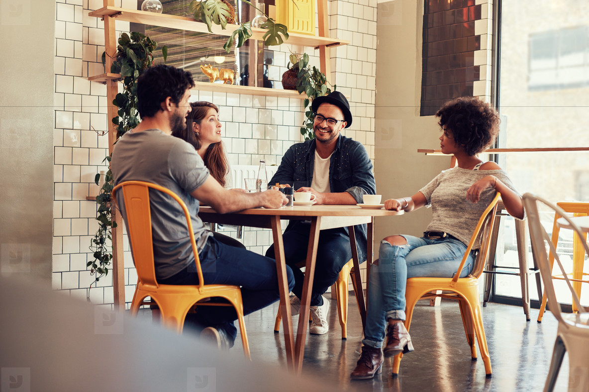 Young people sitting at a cafe table