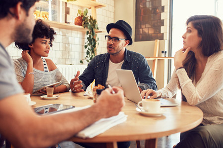 Creative people meeting at a cafe