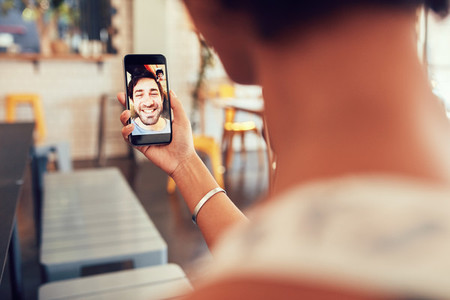 Woman having a video call with man on her smart phone