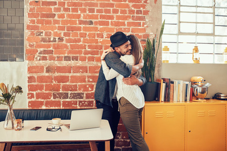 Young couple embracing each other at a coffee