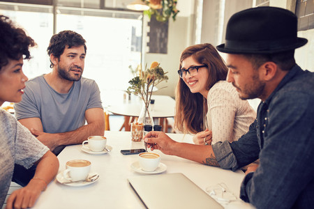 Friends having a discussion over a cup of coffee