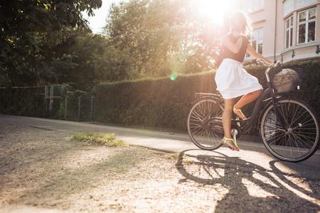 Woman riding a bike on the street