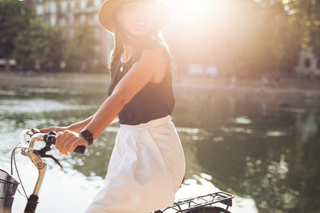 Woman cycling on a summer day
