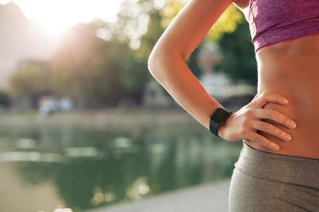 Sportswoman wearing smartwatch